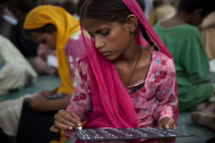 Caption: A girl at a UNICEF-supported school in a relief camp for people affected by the floods in Sukkur, Pakistan., Credit: © UNICEF/PAKA2010-00441/Marta Ramoneda