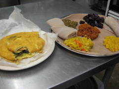 Caption: At RAS, you can order Caribbean food (like the Bake and Shark, left) or Ethiopian cuisine (like the vegetarian platter, right)., Credit: Rebecca Sheir