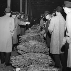 Caption: A tobacco auction from 1959, Credit: WHTJ Charlottesville