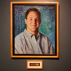 Caption: Daniel Lewin's portrait greets visitors in the main lobby at Akamai's corporate headquarters.  The company co-founder died aboard American Airlines Flight 11 on 9/11., Credit: Jesse Costa