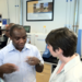 Caption: Seeding Labs' founder Nina Dudnik speaks with a visiting African fellow during a laboratory tour., Credit: Anne Allmeling