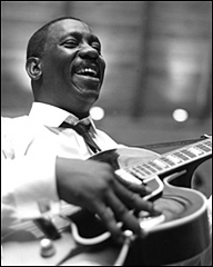 Caption: Wes Montgomery poses in studio., Credit: Chuck Stewart