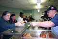 Us_navy_070202-n-8110k-044_sailors_assigned_to_guided_missile_destroyer_uss_mahan__ddg_72__serve_lunch_to_homeless_veterans_at_the_new_england_shelter_for_homeless_veterans_small