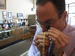 Caption: Jacob Notowitz examines a gold chain at Numis International. , Credit: Callie Shanafelt