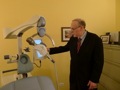 Caption: Philip Janicak of Rush University Medical Center adjusts his TMS machine. , Credit: WBEZ/Gabriel Spitzer