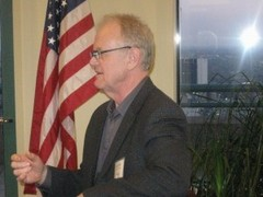 Caption: Tom Wahlrab from Welcome Dayton speaks to Global Detroit.