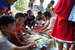 Caption: Children displaced by Tropical Storm Washi look at UNICEF-provided colouring supplies, at a child-friendly space in a high school in the coastal city of Iligan, Northern Mindanao Region. The spaces offer safe places for children to play, learn, and regain, Credit: UNICEF/NYHQ2011-2138/Palasi