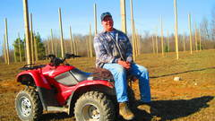 Caption: Part-time farmer Howard Haselhuhn at his West Michigan hops farm., Credit: Lindsey Smith