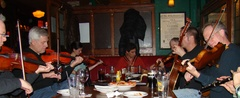 Caption: Musicians perform traditional Irish songs each week at Keegan's in Northeast Minneapolis.