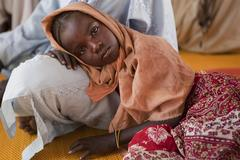 Caption: A girl rests in a UNICEF-supported nutrition centre in Koubigou, a camp for persons displaced by conflict, near the town of Goz Beïda, in the eastern Sila Region., Credit: UNICEF/NYHQ2012-2512/Esteve