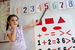 Caption: A girl learns to identify numbers on her first day at a UNICEF-supported preschool in the Baliqchilar settlement, Azerbaijan., Credit: UNICEF/NYHQ2011-1625/Pirozzi
