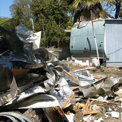 Caption: Demolition at the Village Trailer Park, Credit: Will Coley