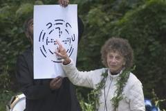 Caption: Anna Halprin explaining the Planetary Dance, Credit: Photo by photo by John Kokoska