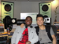 Caption: Rayon Wright with K-Pop Artist JYP