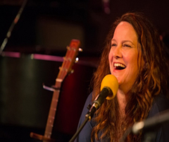 Caption: Kelly Carlin - Daughter of George Carlin & Creator of A Carlin Home Companion, Credit: Jennie Baker for Live Wire!
