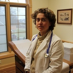 Caption: Amy Pare, a plastic surgeon in heavily-drilled Washington County, Pa. She's found arsenic, benzene, and other drilling-related contaminants in the urine of her patients., Credit: Photo: Reid R. Frazier