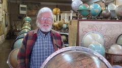 Caption: Murray Hudson in one of his shops crammed full of maps and globes., Credit: Candice Ludlow