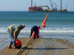 Caption: Laying fiber optic cable, Credit: Cable &amp; Wireless Worldwide