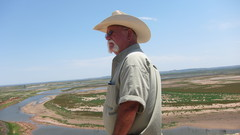 Caption: John Jacobs looks out over the dry EV Spence reservoir, Credit: Photo by Terrence Henry/StateImpact Texas