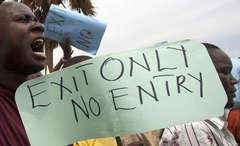 Caption: Ugandan activists holds placards and chant slogans during an anti-homosexuality protest rally in the industrial city of Jinja, Uganda, February 15, 2010., Credit: (REUTERS/James Akena)