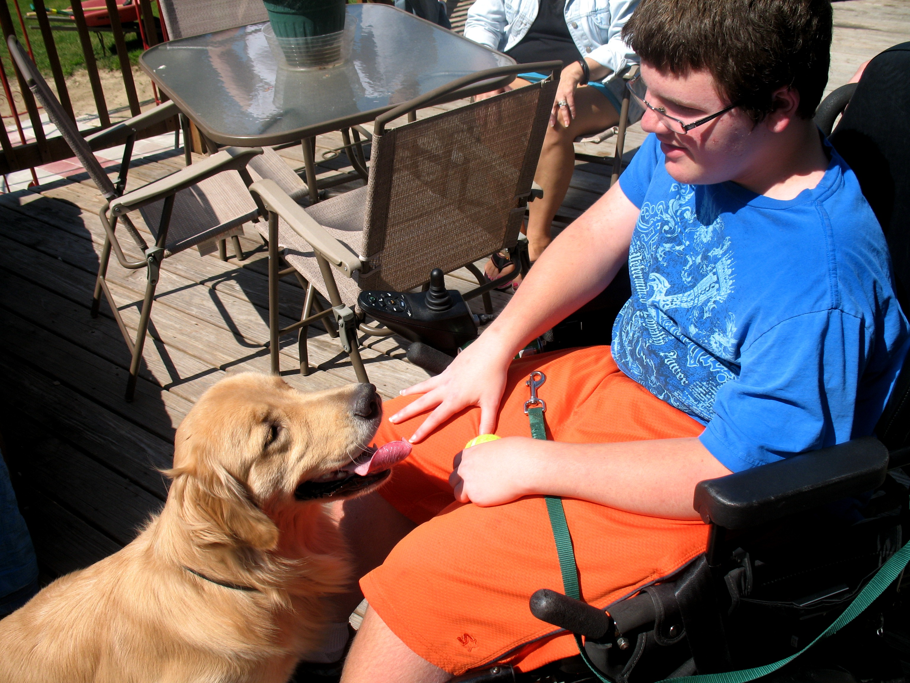 Caption: Mario Study with his service dog, Zen., Credit: Brian Bull, WCPN.
