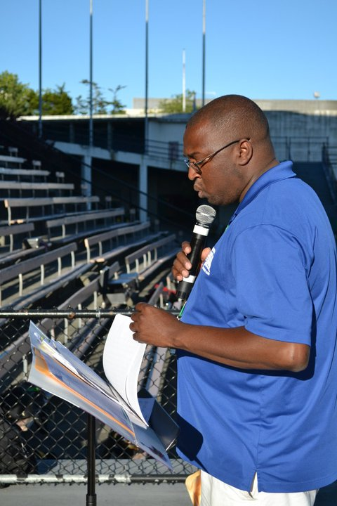 Caption: Marcus Pimpleton directing at an All-City Band Rehearsal in Memorial Stadium., Credit: Kristin Viray