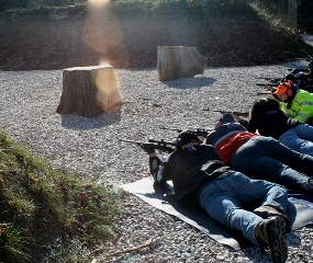 Caption: Project Appleseed students take aim.  Instructor Kate Bixler is in yellow at right., Credit: Peter Shirley, Y-Press