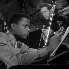 Caption: Sidney Poitier and Paul Newman in the 1961 movie, &quot;Paris Blues&quot;