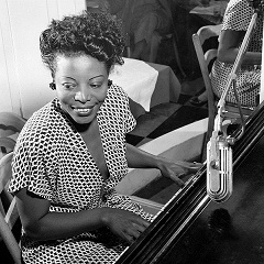 Caption: Adopted Kansas City hero Mary Lou Williams swingin' in 1946. , Credit: William Gottlieb