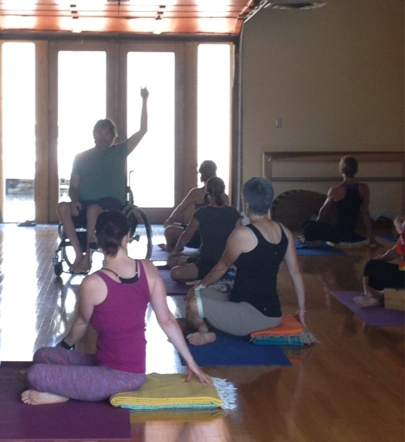 Caption: Matthew Sanford teaches adaptive yoga in Minneapolis.