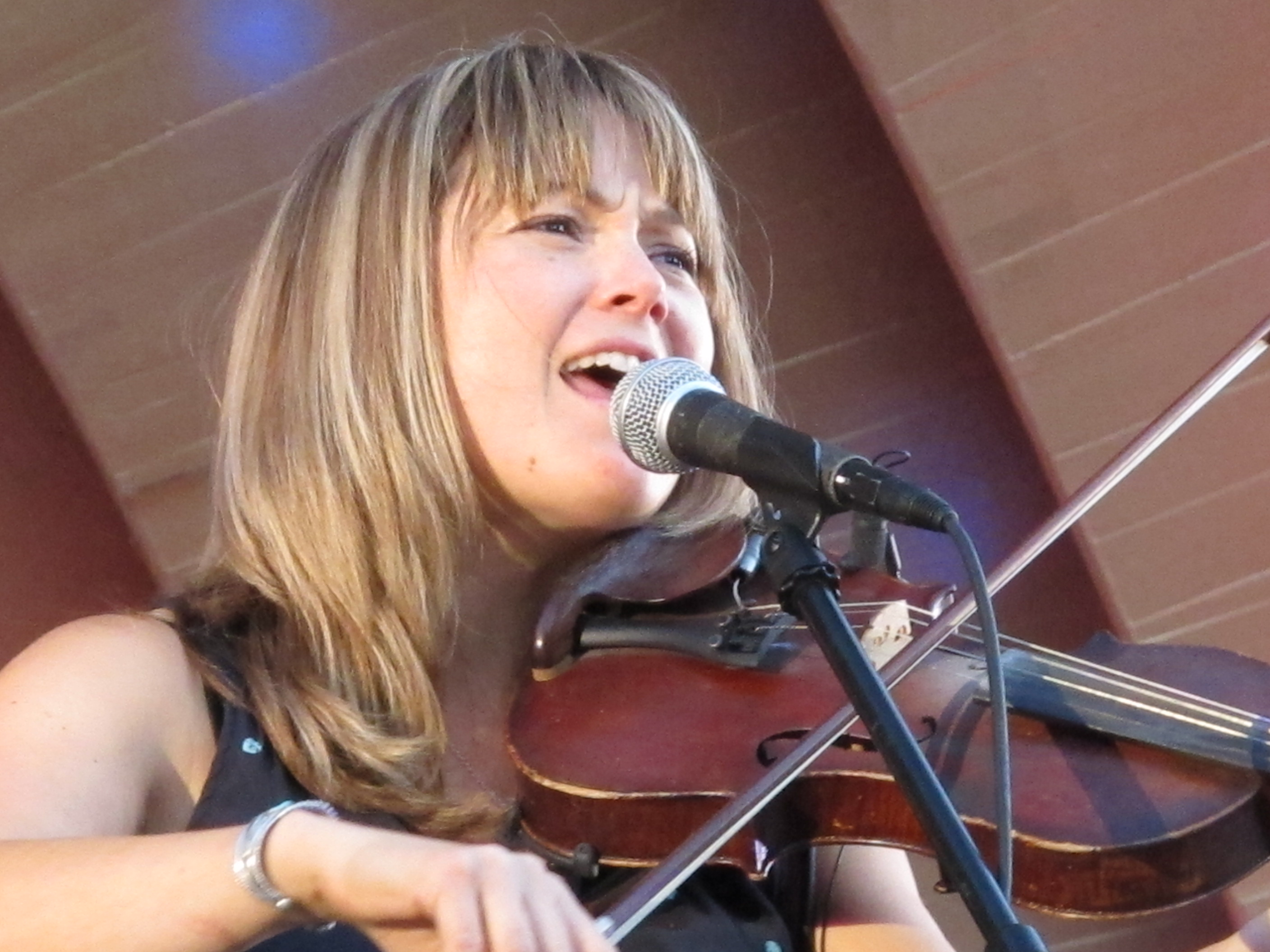 Caption: Sara Watkins sings and fiddles during a recent concert in Pasadena, California., Credit: Susan Valot