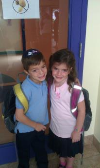 Caption: Shloimy and Rachel on their first day of Hebrew school