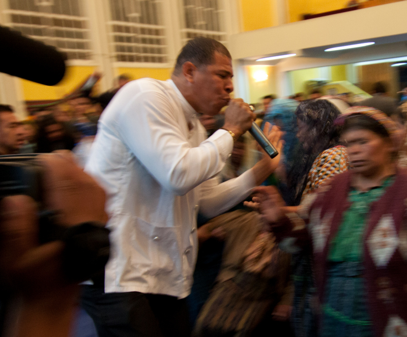 Caption: Pastor Omar Bell laying on hands in El Calvario Church, Almolonga, Guatemala, Credit: Jesse Dukes