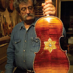 Caption: Amnon Weinstein, with a Violin of Hope, Credit: Ken Lambla