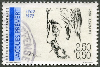 Caption: French postage stamp with portrait of Jacques Prvert by Pablo Picasso, Credit: Olga Popova