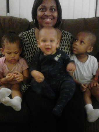 Caption: A family photo of Keisha Johnson and her three children, Credit: Keisha Johnson