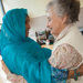 Caption: Jane York and Nura Adam embrace at a meeting, Credit: Lisa Merrill, Bellevue WA
