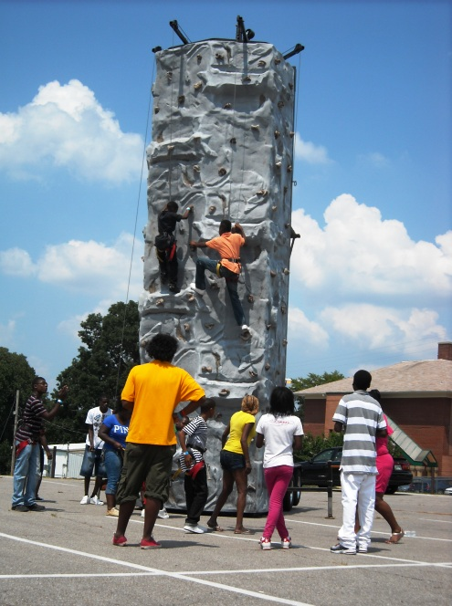Caption: A rock-climbing wall was one of the attractions set up for the Achievement School District picnic in Frayser.