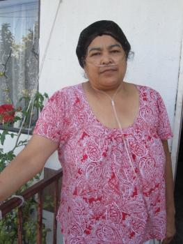 Caption: Reyna Lopez Calderon, 52, suffers from chronic asthma in Wilmington, California. She lives in a neighborhood with a high concentration of oil refineries, the 110 and 710 freeways, and the busiest seaport in the nation., Credit:  (Photo: D. Merina)