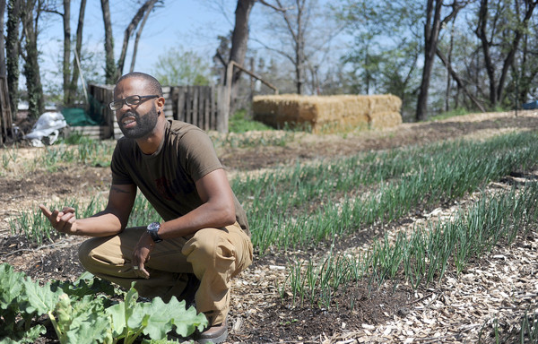 Caption: Denzel Mitchell of Five Seeds Farm and Apiary