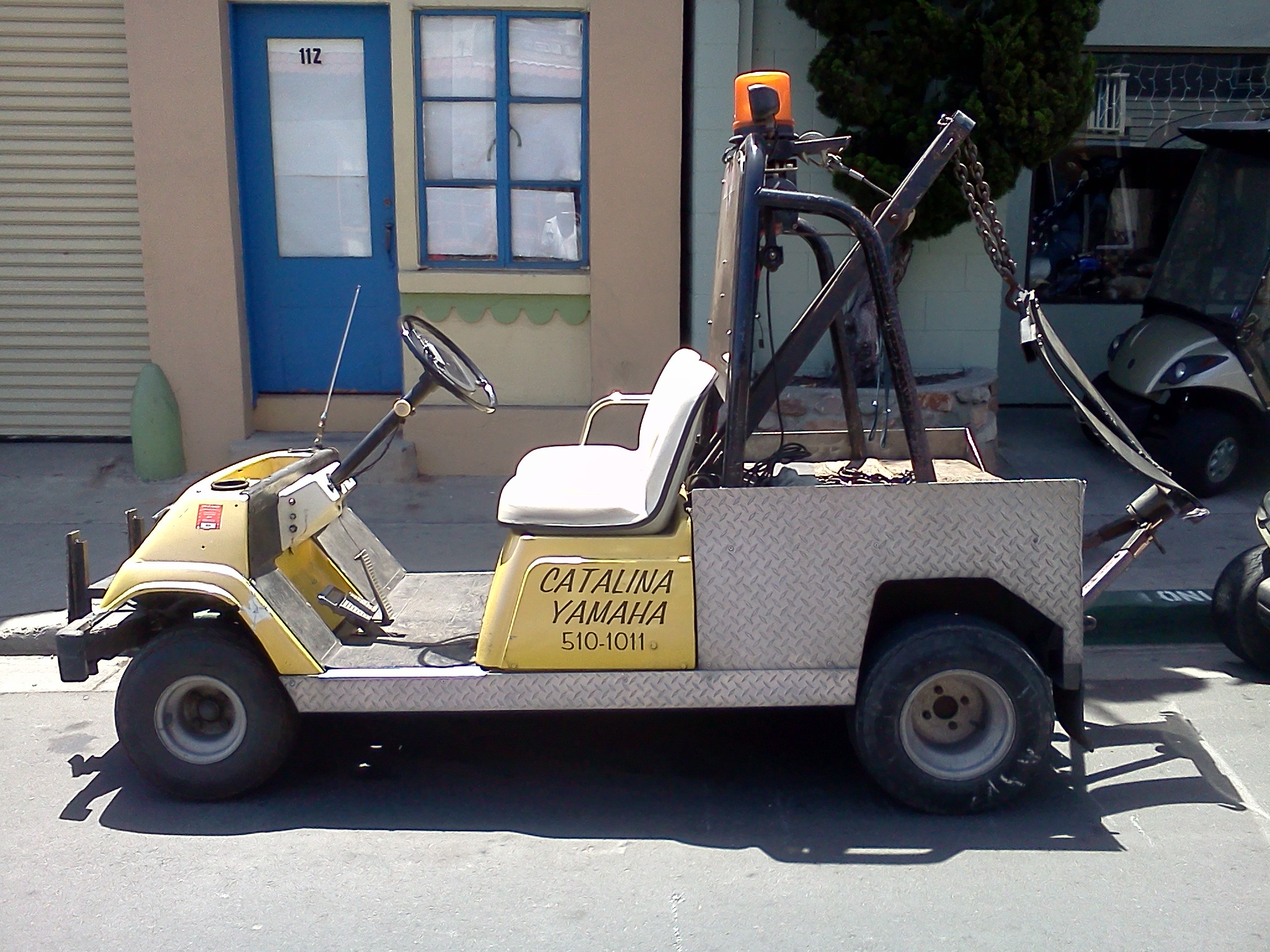 Caption: A golf cart for towing golf carts, Credit: Alex Ward