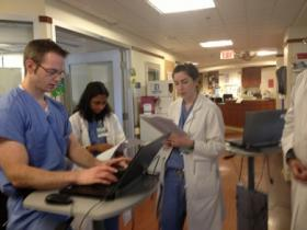 Caption: Resident Anne Kuritzky begins morning rounds on the surgical intensive care unit., Credit: Kristin Gourlay