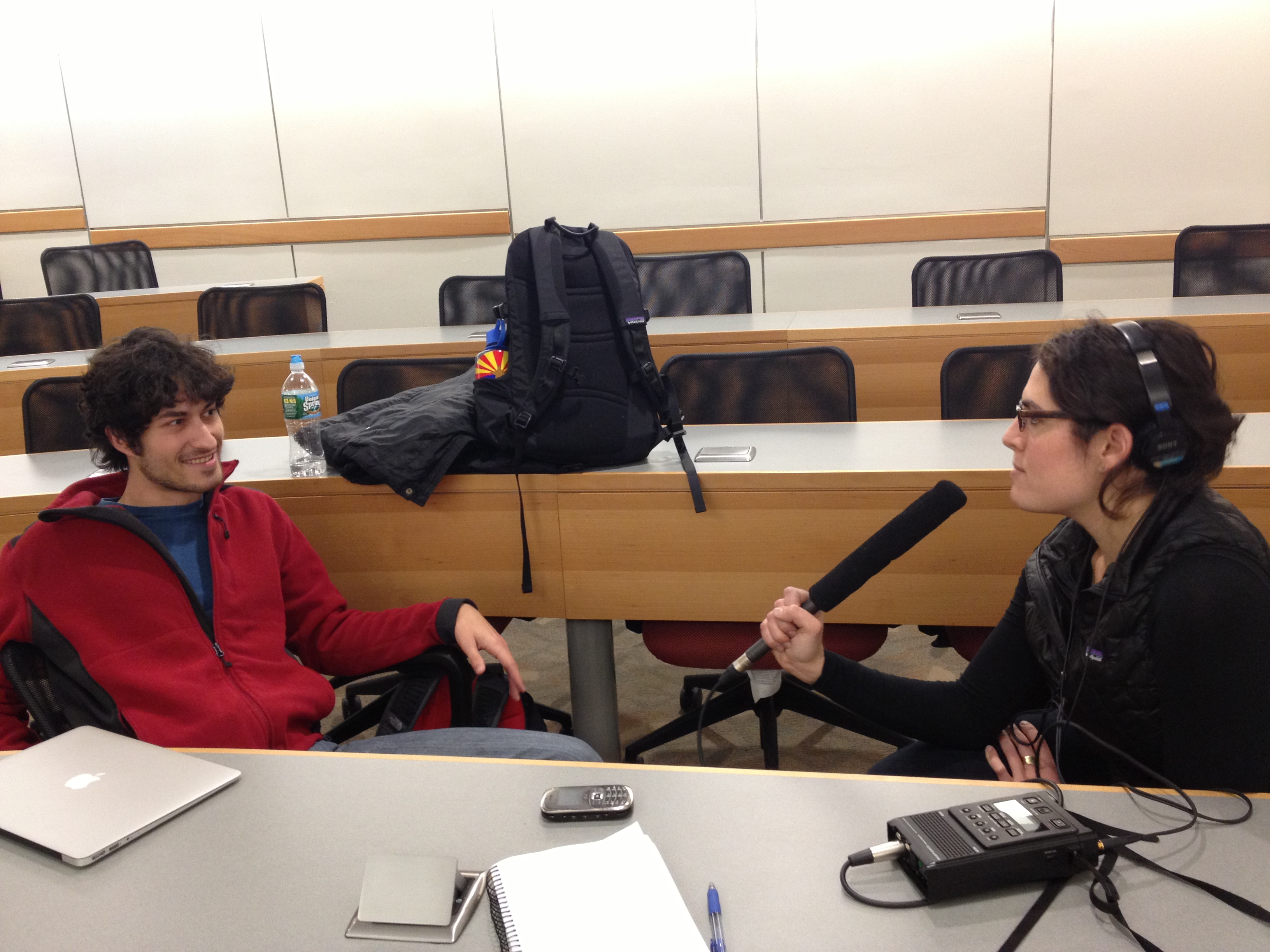Caption: Second year medical student Sarah Rapoport grabs the mic and interviews fellow student Peter Kaminski., Credit: Kristin Gourlay
