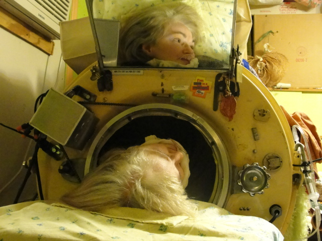 Caption: Martha Lillard, 65, uses her iron lung to breathe at night., Credit: Julia Scott