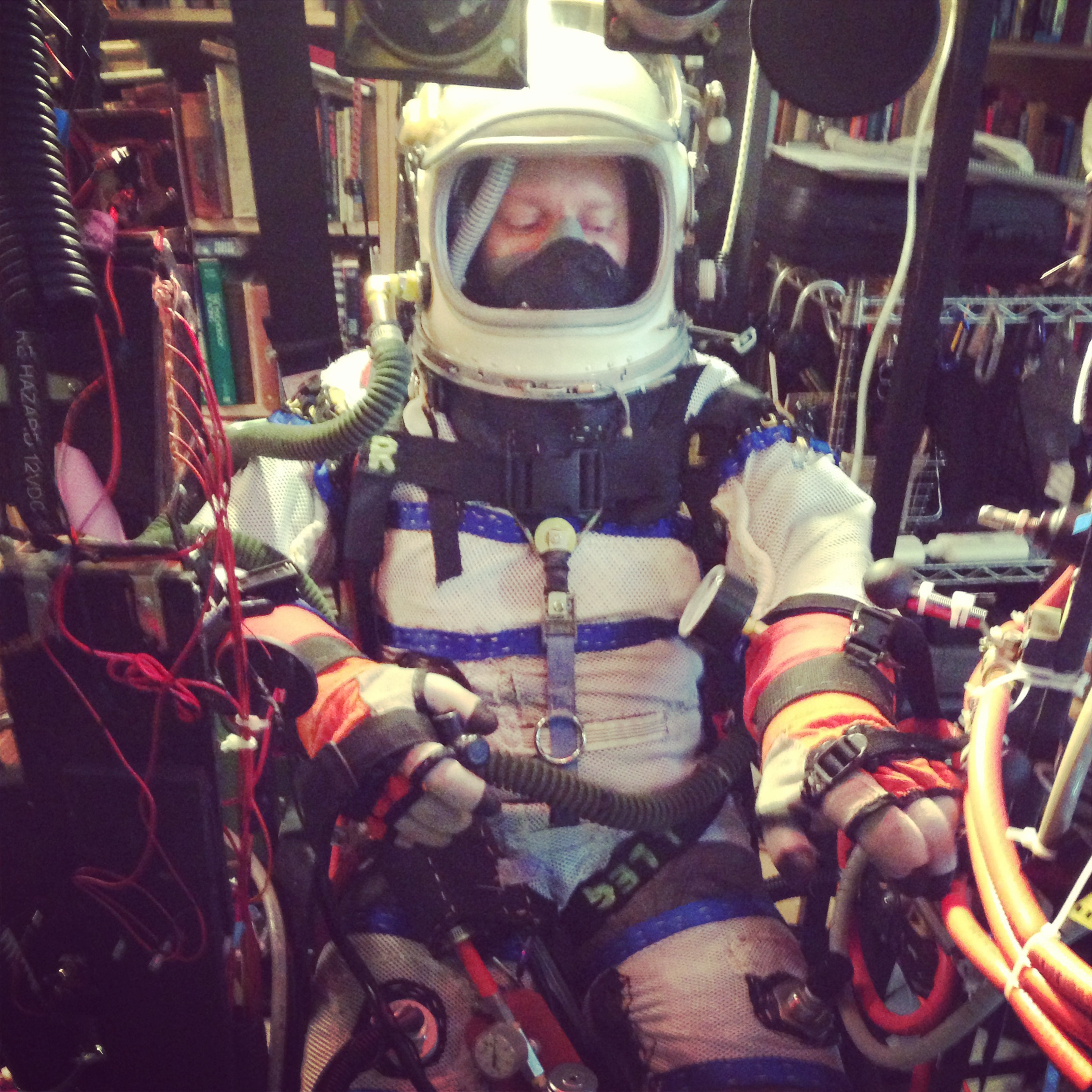 Caption: Cameron Smith testing out his homemade, hand-sewn space suit, Credit: Julie Sabatier