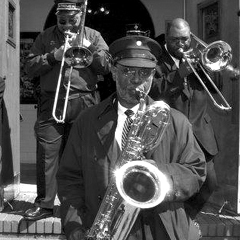Caption: The Dirty Dozen Brass Band's Roger Lewis at a jazz funeral in 2010. , Credit: Kim Welsh