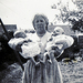 Caption: Sheila Hayes, holding two of 208 babies that she fostered.