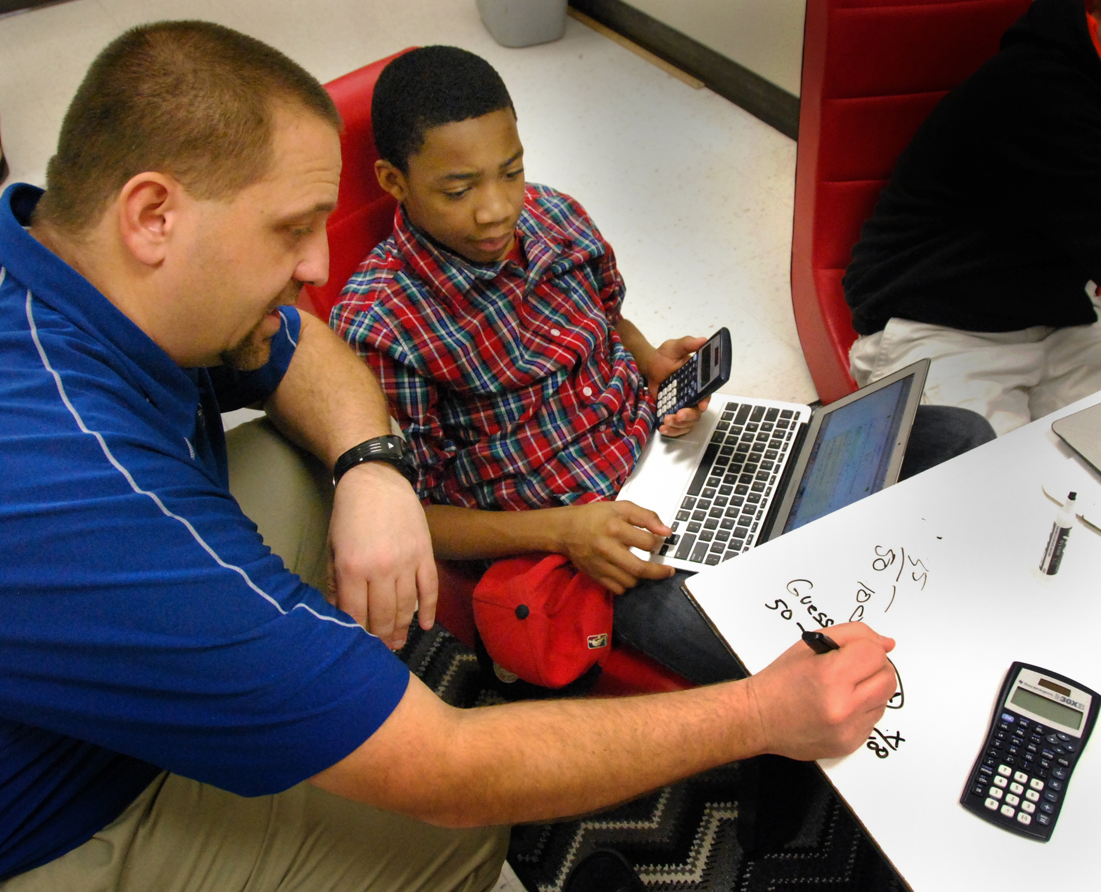 Caption: Working a math problem at Mooresville Middle School in North Carolina, where each student gets a laptop., Credit: Stephen Smith