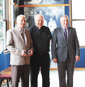 Caption: Bytow (Poland) Mayor Ryszard Sylka, at left, along with Father Paul Breza and Bytow City Council Chairman Leszek Waszkiewicz, visited the Winona Polish Heritage Museum last week. The Bytow leaders traveled to Winona to celebrate the 50th anniversary of Fa, Credit: Photo by Sarah Squires of the Winona Post