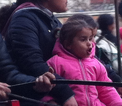 Caption: Girl on the family cart, Credit: Ben Weisz 2013